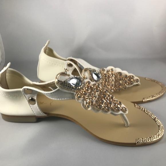 62de0c4ec9f7 Sz 7 sandals with Peacock embellishment NWOT